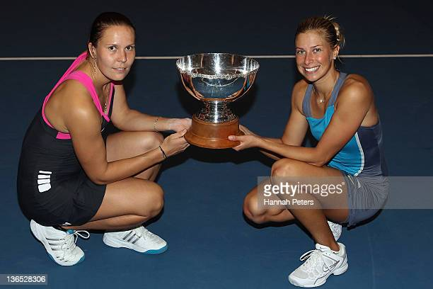 Lucie Hradecka and Andrea Hlavackova of the Czech Republic hold the trophy up after beating Flavia Pennetta of Italy and Julia Goerges of Germany in...