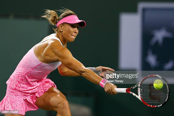 Lucie Hradecka of Czech Republic in action against Eugenie Bouchard of Canada during day six of the BNP Paribas Open tennis at the Indian Wells...