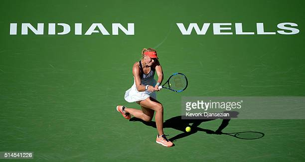 Lucie Hradecka of the Czech Republic hits a backhand against Alison Riske of the United States during day three of the BNP Paribas Open at Indian...