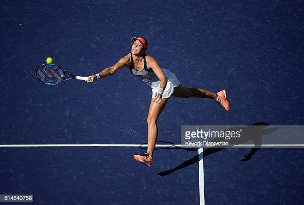 Lucie Hradecka of the Czech Republic hits a forehand against Alison Riske of the United States during day three of the BNP Paribas Open at Indian...