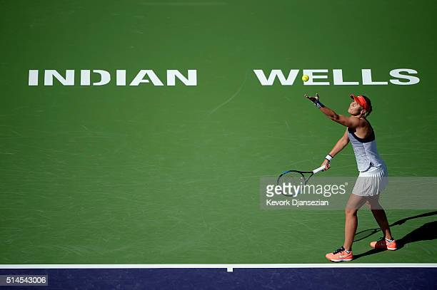 Lucie Hradecka of the Czech Republic hits serves against Alison Riske of the United States during day three of the BNP Paribas Open at Indian Wells...