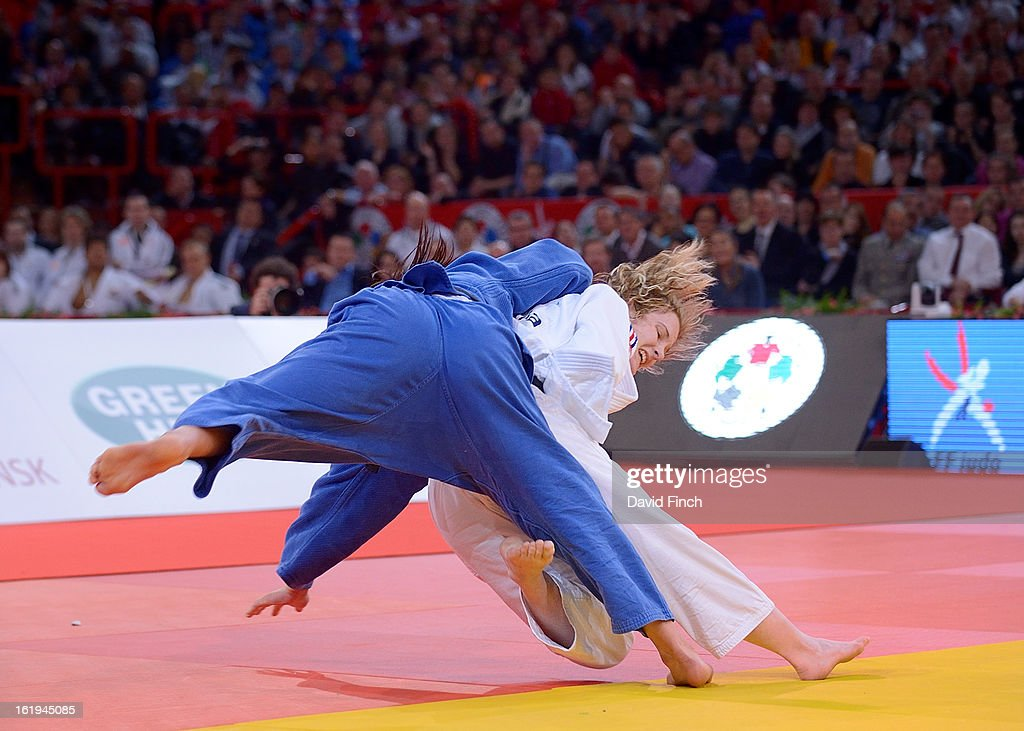 Lucie Louette of France (white) attacks World silver medallist, <a gi-track='captionPersonalityLinkClicked' href=/galleries/search?phrase=Akari+Ogata&family=editorial&specificpeople=6583429 ng-click='$event.stopPropagation()'>Akari Ogata</a> of Japan, during the u78kgs final that Louette won by a yuko (5 points) at the Paris Grand Slam on day 2, Sunday, February 10, 2013 at the Palais Omnisports de Paris, Bercy, Paris, France.