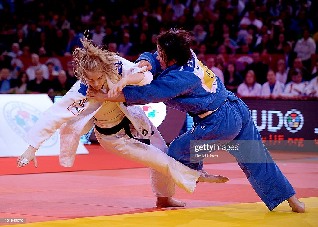Lucie Louette of France (white) avoids an attack by <a gi-track='captionPersonalityLinkClicked' href=/galleries/search?phrase=Akari+Ogata&family=editorial&specificpeople=6583429 ng-click='$event.stopPropagation()'>Akari Ogata</a> of Japan in the u78kgs final eventually winning the contest and gold medal during the Paris Grand Slam on day 2, Sunday, February 10, 2013 at the Palais Omnisports de Paris, Bercy, Paris, France.