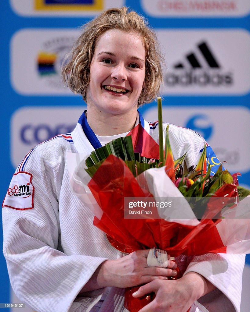 Lucie Louette of France beams with happiness after winning the u78kgs gold medal during the Paris Grand Slam on day 2, Sunday, February 10, 2013 at the Palais Omnis