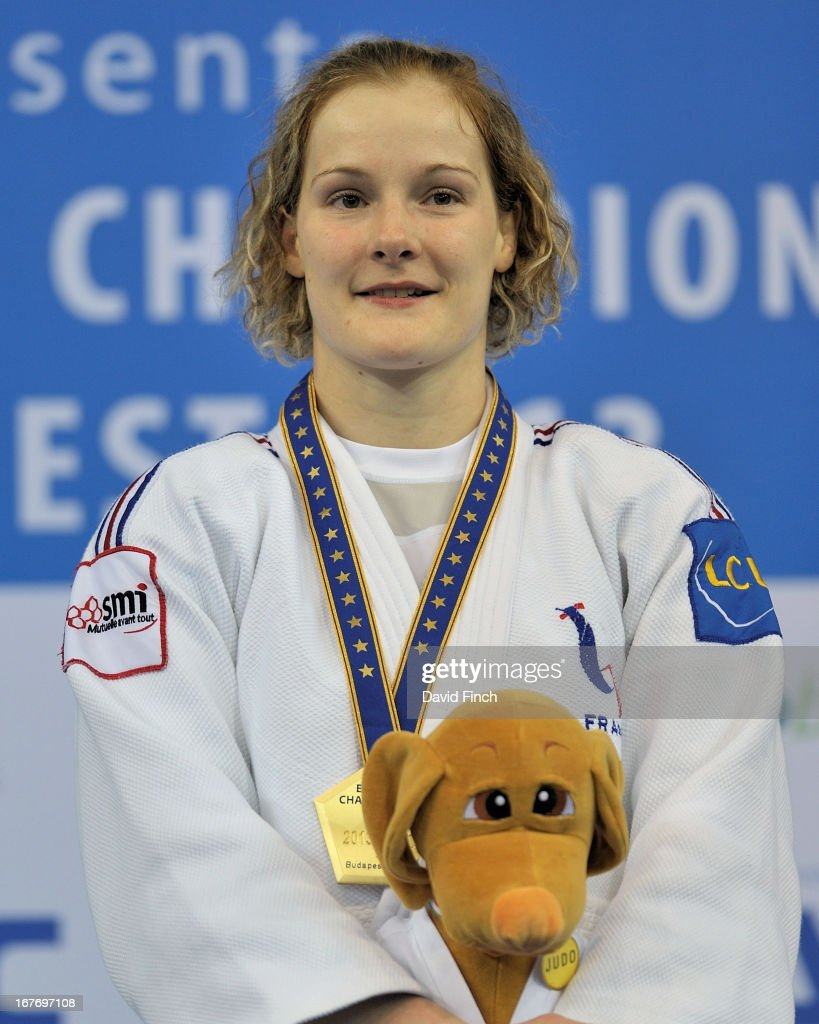 Lucie Louette of France poses with the championship mascot and her u78kgs gold medal during the Budapest European Championships at the Papp Laszlo Sports Hall on April 27, 2013 in Budapest, Hungary.