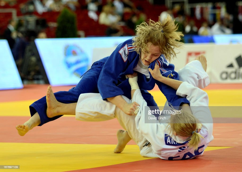 Lucie Louette of France (blue) throws Ana Velensek of Slovenia for ippon (10 points) to win the u78kgs final during the Budapest European Championships at the Papp Laszlo Sports Hall on April 27, 2013 in Budapest, Hungary.