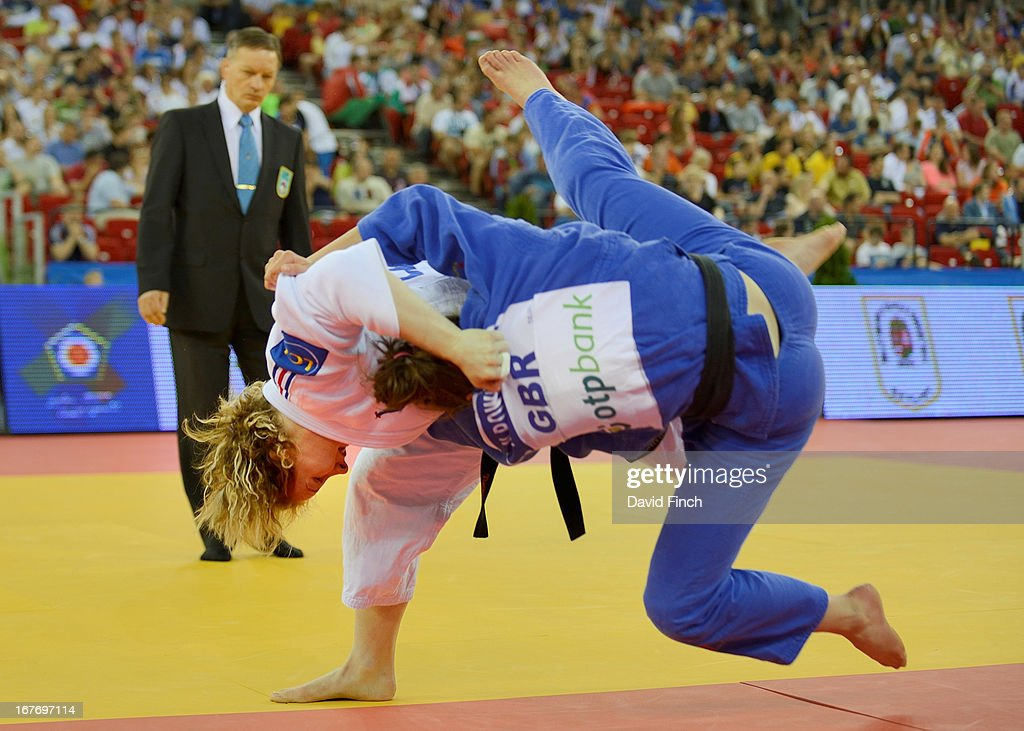 Lucie Louette of France (white) throws Natalie Powell of Great Britain for ippon (10 points) during their u78kgs contest during the Budapest European Championships at the Papp Laszlo Sports Hall on April 27, 2013 in Budapest, Hungary.