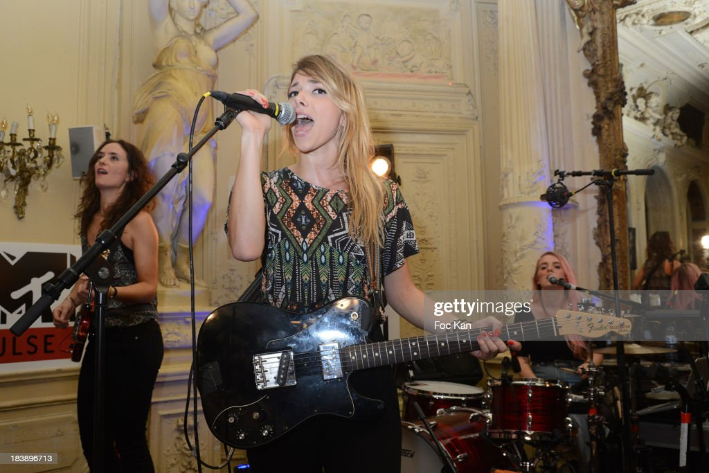 Lucie Petre, Katty Besnard and Anais Vandevyvere from The Plastiscines perform during the the Plastiscines private concert hosted by MTV Pulse at The Carmen Club on October 9, 2013 in Paris, France.