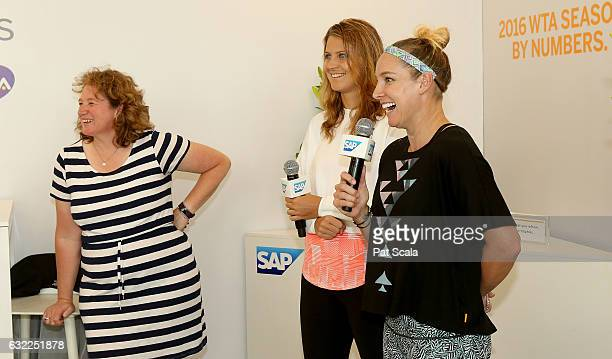 Lucie Safarova and Bethanie MattekSands speaking with Jenni Lewis from SAP in The SAP Corporate Suite during day 6 of the 2017 Australian Open at...