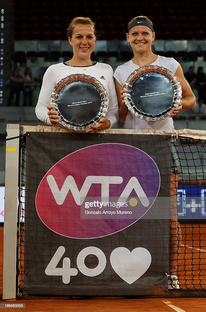 Lucie Safarova (R) of Czech Republic and her doubles partner <a gi-track='captionPersonalityLinkClicked' href=/galleries/search?phrase=Anastasia+Pavlyuchenkova&family=editorial&specificpeople=579686 ng-click='$event.stopPropagation()'>Anastasia Pavlyuchenkova</a> of Russia pose with their trophies after winning their final match against Marina Erakovic of New Zealand and Cara Black of Zimbabwe on day eight of the Mutua Madrid Open tennis tournament at the Caja Magica on May 11, 2013 in Madrid, Spain.