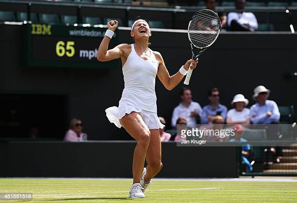 Lucie Safarova of Czech Republic celebrates after winning her Ladies' Singles quarterfinal match against Ekaterina Makarova of Russia on day eight of...