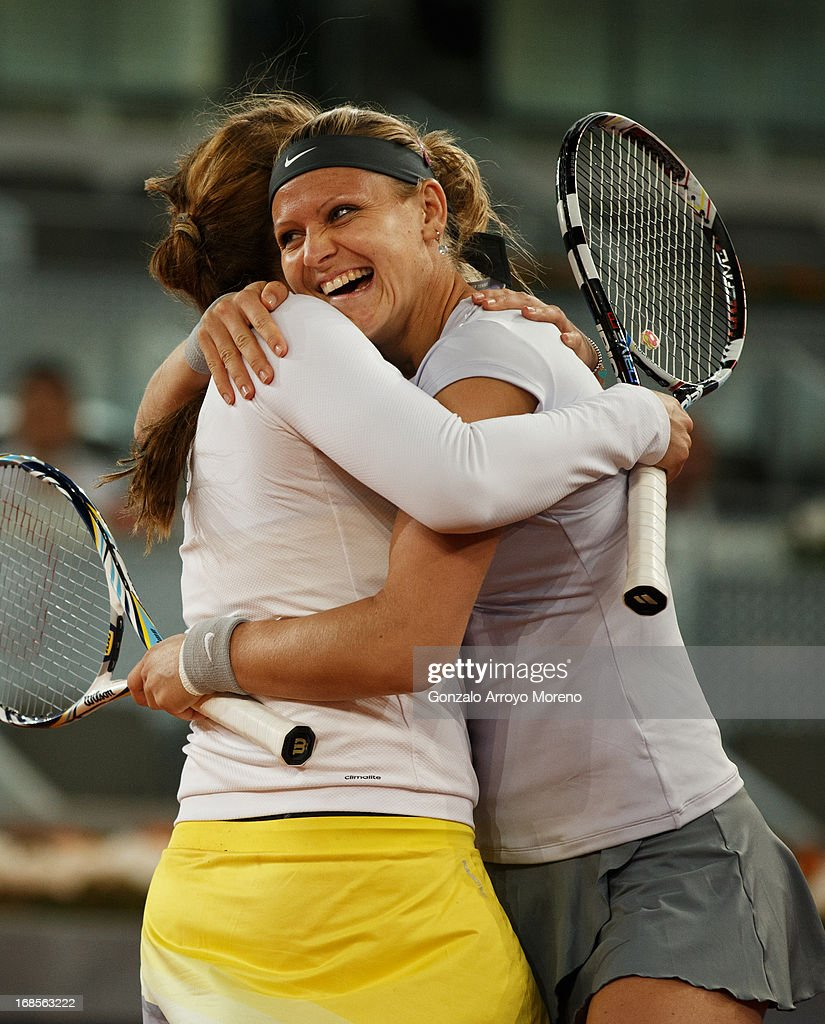 Lucie Safarova (R) of Czech Republic celebrates matchpoint with her doubles partner <a gi-track='captionPersonalityLinkClicked' href=/galleries/search?phrase=Anastasia+Pavlyuchenkova&family=editorial&specificpeople=579686 ng-click='$event.stopPropagation()'>Anastasia Pavlyuchenkova</a> of Russia during their final match against Marina Erakovic of New Zealand and Cara Black of Zimbabwe on day eight of the Mutua Madrid Open tennis tournament at the Caja Magica on May 11, 2013 in Madrid, Spain.