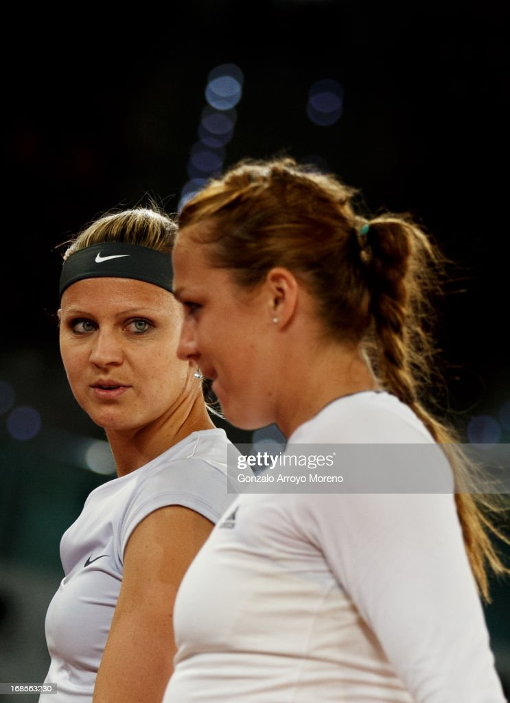 Lucie Safarova (L) of Czech Republic chats with her doubles partner <a gi-track='captionPersonalityLinkClicked' href=/galleries/search?phrase=Anastasia+Pavlyuchenkova&family=editorial&specificpeople=579686 ng-click='$event.stopPropagation()'>Anastasia Pavlyuchenkova</a> of Russia during their final match against Marina Erakovic of New Zealand and Cara Black of Zimbabwe on day eight of the Mutua Madrid Open tennis tournament at the Caja Magica on May 11, 2013 in Madrid, Spain.
