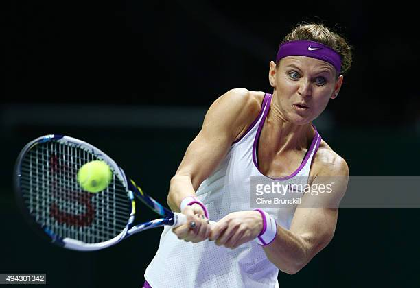 Lucie Safarova of Czech Republic in action against Garbine Muguruza of Spain in a round robin match during the BNP Paribas WTA Finals at Singapore...