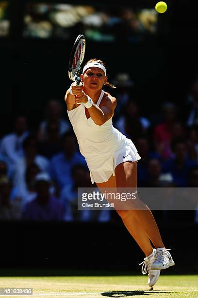 Lucie Safarova of Czech Republic plays a backhand return during her Ladies' Singles semifinal match against Petra Kvitova of Czech Republic on day...