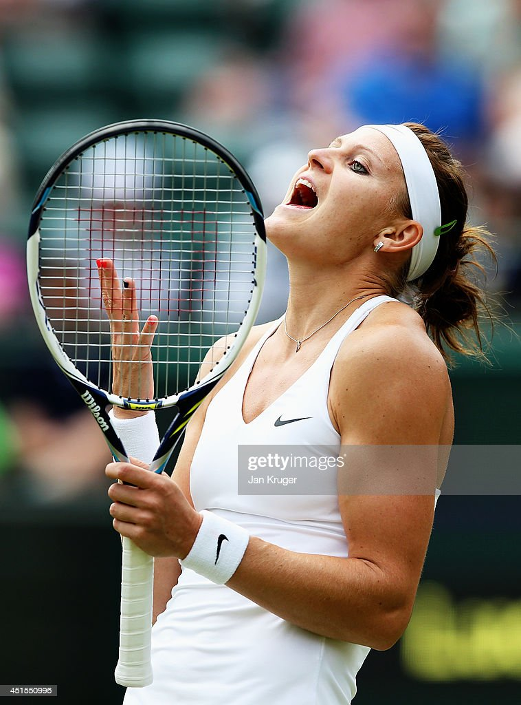 Lucie Safarova of Czech Republic reacts during her Ladies' Singles quarter-final match against Ekaterina Makarova of Russia on day eight of the Wimbledon Lawn Tennis Championships at the All England Lawn Tennis and Croquet Club on July 1, 2014 in London, England.