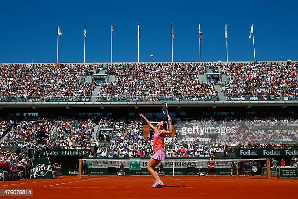 Lucie Safarova of Czech Republic serves in the Women's Singles Final againt Serena Williams of the United States on day fourteen of the 2015 French...