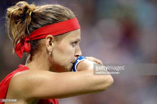 Lucie Safarova of Czech Republic wipes her face between points while playing Sloane Steohens during day 4 of the Western Southern Open at the Lindner...
