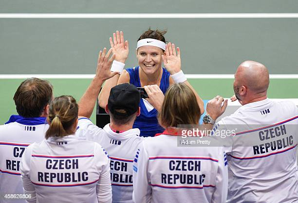 Lucie Safarova of the Czech Republic celebrates with team mates after winning the second rubber of the Fed Cup Final between Lucie Safarova of the...