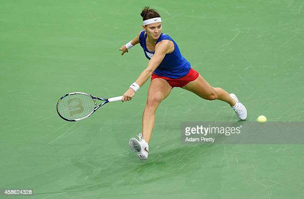 Lucie Safarova of the Czech Republic lunges for a backhand during the second rubber of the Fed Cup Final between Lucie Safarova of the Czech Republic...