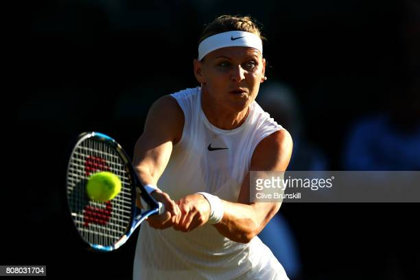 Lucie Safarova of The Czech Republic plays a forehand during the Ladies Singles first round match Oceane Dodin of France on day two of the Wimbledon...