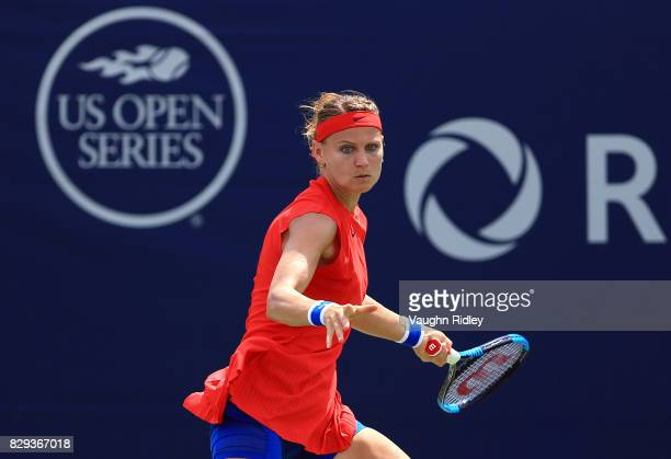 Lucie Safarova of the Czech Republic plays a shot against Ekaterina Makarova of Russia during Day 6 of the Rogers Cup at Aviva Centre on August 10...