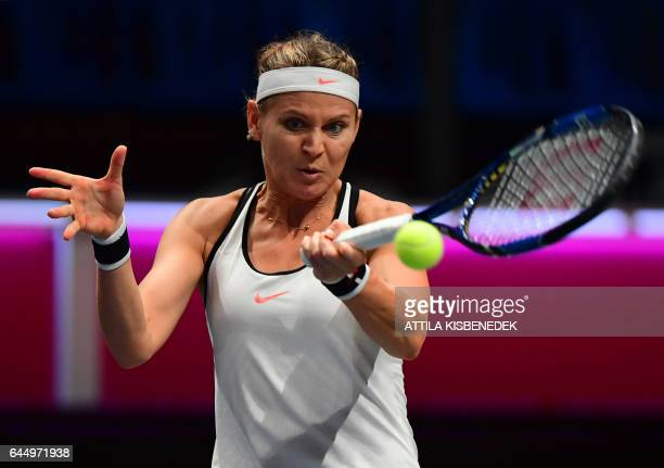 Lucie Safarova of the Czech Republic returns the ball during her match against Aliaksandra Sasnovich of Belarus during the WTA Hungarian Open Ladies...