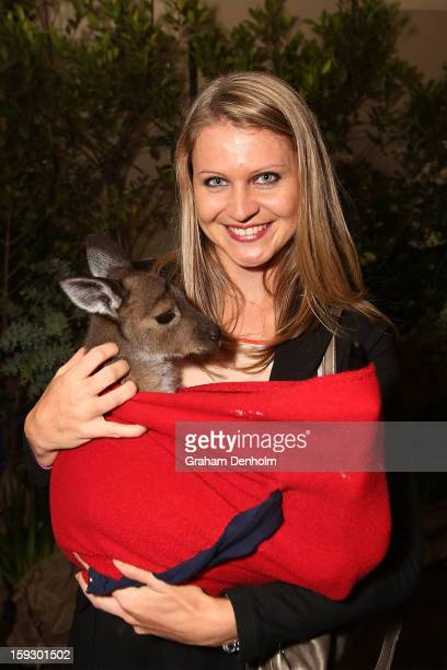 Lucie Safarova poses with a joey as she arrives at the official Australian Open player party at the Grand Hyatt on January 11 2013 in Melbourne...