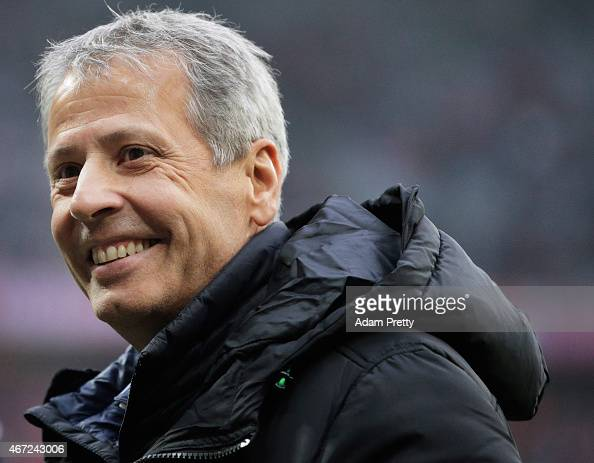 Lucien Favre head coach of Borussia Moenchengladbach smiles before the Bundesliga match between Bayern Muenchen and Borussia Moenchengladbach at...
