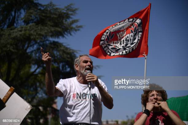 Luciero Pati a 'No Tap' activist against the Trans Adriatic Pipeline speaks during a demonstration on the second day of a G7 summit of Finance...