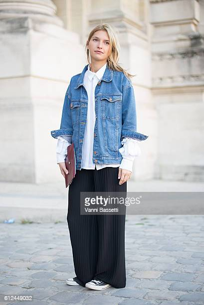 Lucilia Chenel poses wearing a Monki denim jacket H and M pants Comme des Garcons shirt and Converse shoes before the Shiatzy Chen show at the Grand...