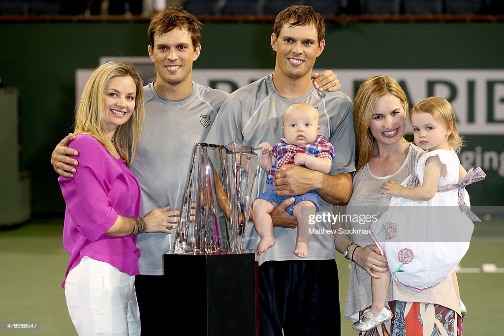 Lucille and <a gi-track='captionPersonalityLinkClicked' href=/galleries/search?phrase=Mike+Bryan&family=editorial&specificpeople=204456 ng-click='$event.stopPropagation()'>Mike Bryan</a>, Bob and Michelle Bryan and their children Micaela and Robert pose photographers after defeating Alexander Peya of Austria and Bruno Soares of Brazil during the doubles final of the BNP Parabas Open at the Indian Wells Tennis Garden on March 15, 2014 in Indian Wells, California.
