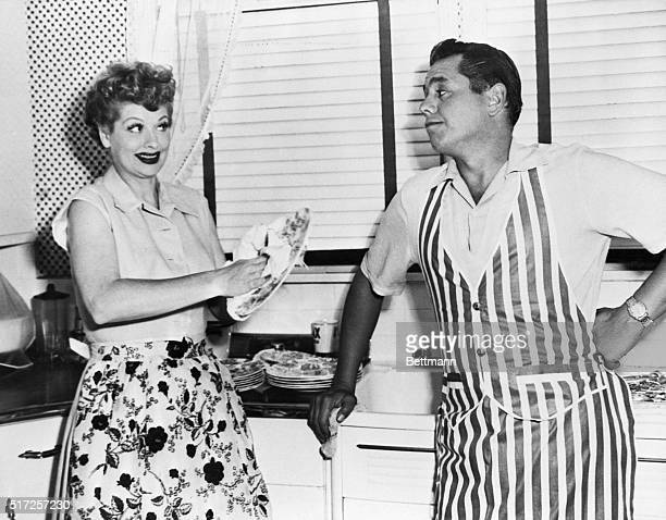 Lucille Ball and Desi Arnaz washing dishes at home on their five acre ranch