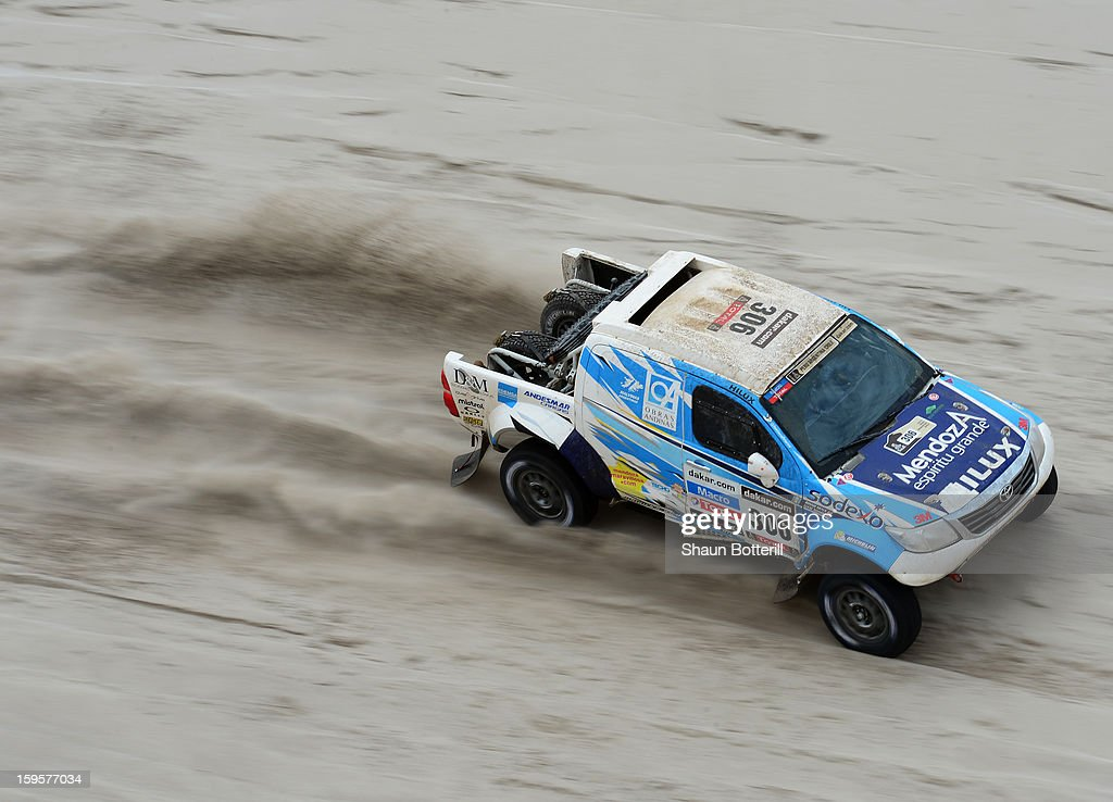 Lucio Alvarez and co-driver Ronnie Graue of team Toyota compete in stage 11 from La Rioja to Fiambala during the 2013 Dakar Rally on January 16 in La Rioja, Argentina.