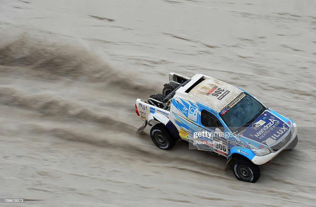 Lucio Alvarez and co-driver Ronnie Graue of team Toyota compete in stage 11 from La Rioja to Fiambala during the 2013 Dakar Rally on January 16, 2013 in La Rioja, Argentina.