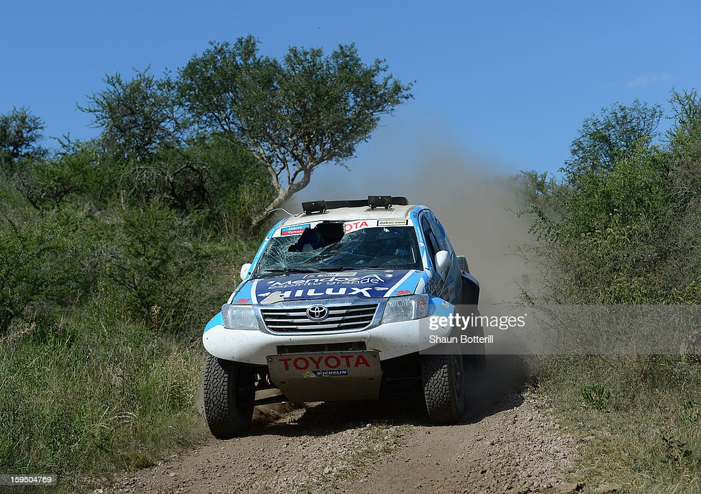 Lucio Alvarez and co-driver Ronnie Graue of team Toyota drive with a broken windscreen in stage 9 from Tucuman to Cordoba during the 2013 Dakar Rally on January 14 in Tucuman, Argentina.