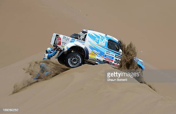 Lucio Alvarez and codriver Ronnie Graue of team Toyota try to move their stranded car during stage 6 from Arica to Calama during the 2013 Dakar Rally...