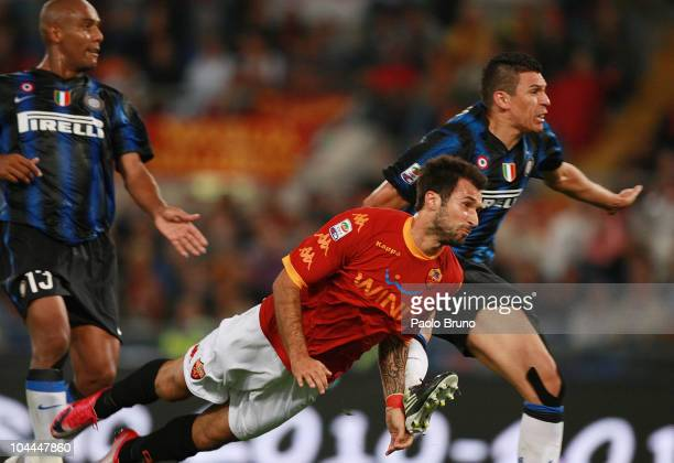 Lucio and Maicon of FC Internazionale Milano fail to stop Mirko Vucinic of AS Roma scoring the 10 goal in the 90th minute during the Serie A match...