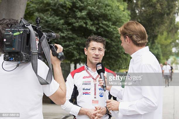 Lucio Cecchinello of Italy and LCR Honda MotoGP speaks with journalist in the paddock during the MotoGP Tests In Sepang at Sepang Circuit on January...