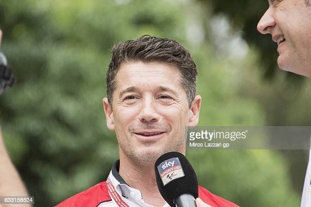 Lucio Cecchinello of Italy and LCR Honda MotoGP speaks with journalists in the paddock during the MotoGP Tests In Sepang at Sepang Circuit on January...