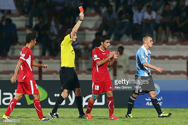 Lucio Compagnucci of Argentina is sent off by referee Pavel Kralovec during the FIFA U17 World Cup UAE 2013 Group E match between Iran and Argentina...