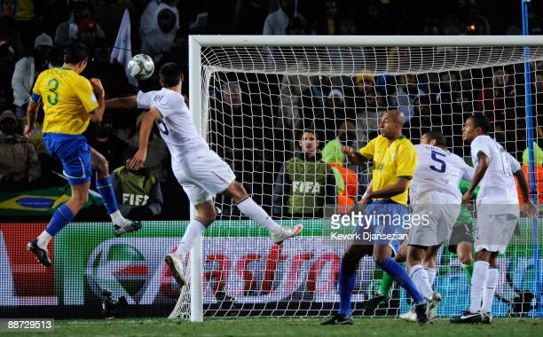 Lucio of Brazil rises to head the winning goal during the FIFA Confederations Cup Final between USA and Brazil at the Ellis Park Stadium on June 28...