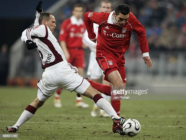 Lucio of FC Bayern Munich and Jan Polak of 1 FC Nuremberg battle for the ball during the Bundesliga match between FC Bayern Munich and 1 FC Nuremberg...