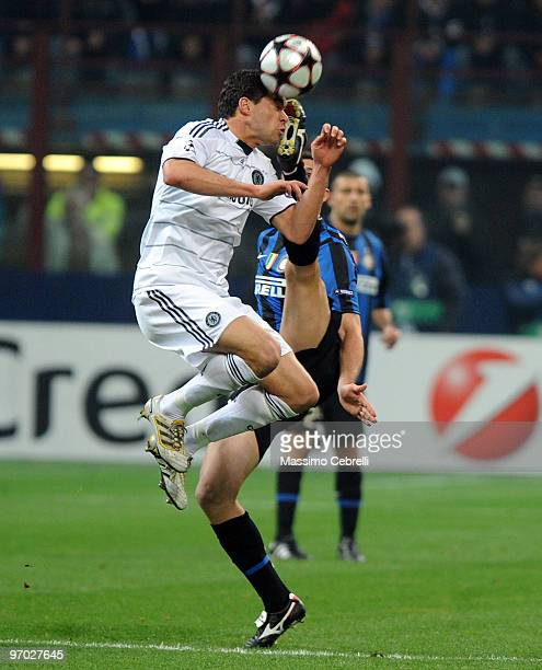 Lucio of FC Inter Milan battles for the ball against Michael Ballack of Chelsea during the UEFA Champions League round of 16 first leg match between...