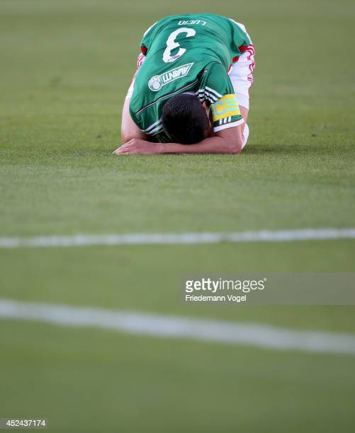Lucio of Palmeiras is injured during the match between Palmeiras and Cruzeiro for the Brazilian Series A 2014 at Estadio do Pacaembu on July 20 2014...