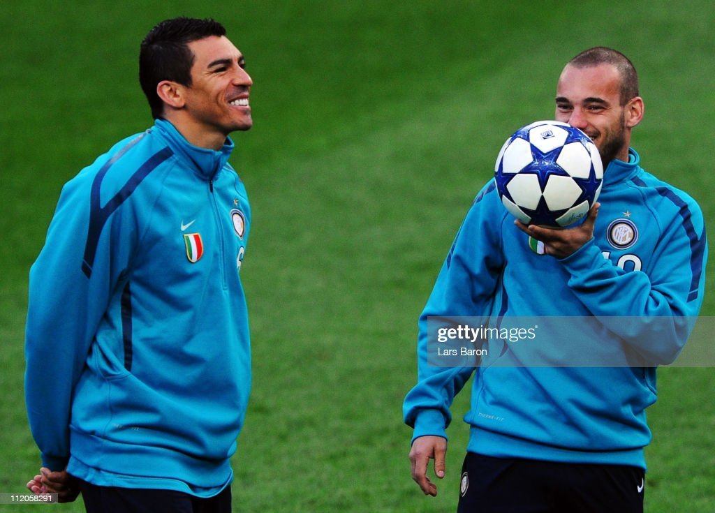 Lucio smiles next to Wesley Sneijder during a Inter Milan training session ahead of the UEFA Champions League quarter final second leg match against FC Schalke 04 at Veltins Arena on April 12, 2011 in Gelsenkirchen, Germany.
