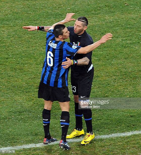 Lucioand Marco Materazzi of Inter celebrate the victory after the Serie A match between Udinese and Inter at Stadio Friuli on February 28 2010 in...