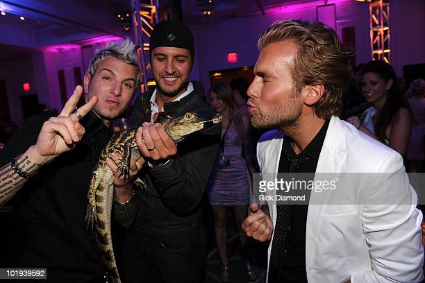 Luck Bryan with Tom Gossin and Mike Gossin of Gloriana at the 2010 CMT Music Awards after party at the Hutton Hotel on June 9 2010 in Nashville...