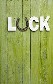 Luck word written on wooden plank.