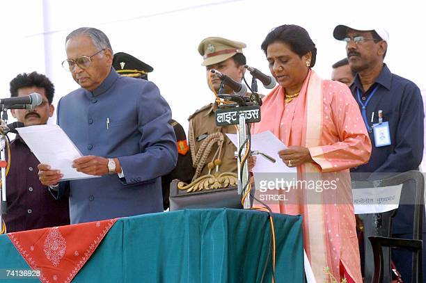Recently elected Chief Minister of the Indian state of Uttar Pradesh Mayawati taks an oath of office as state governor TV Rajeshwar and others look...